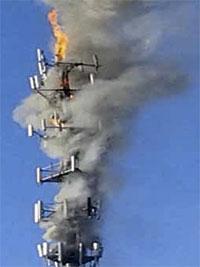 Burning telephone tower
